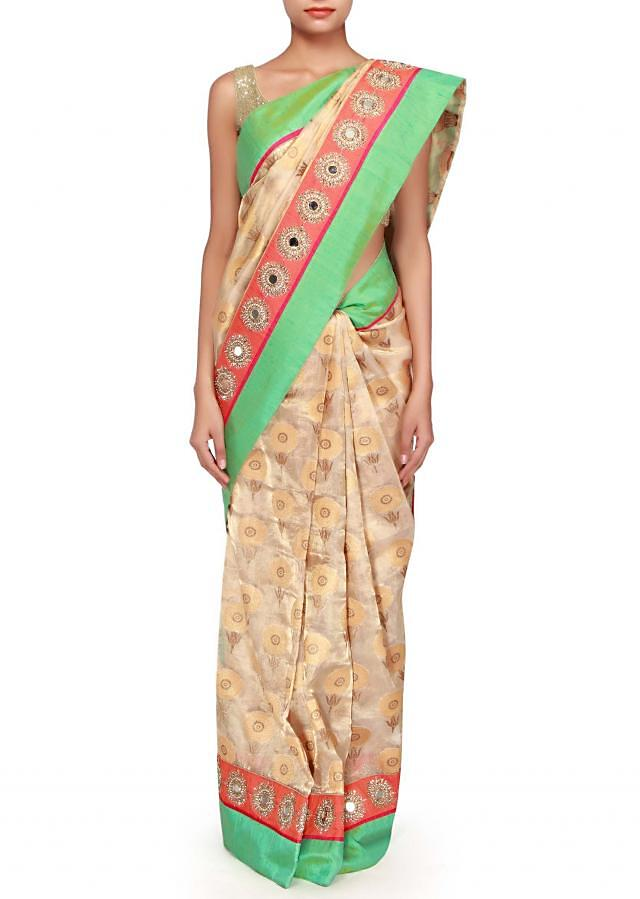 Clear gold saree with mirror embellished border only on Kalki