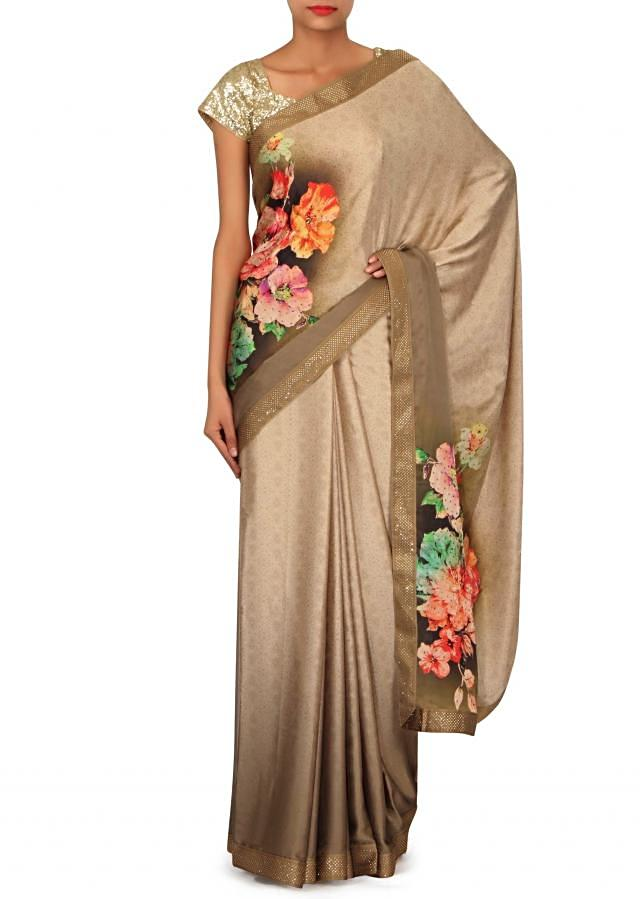 Glowing gold satin saree in floral print and kundan border only on Kalki