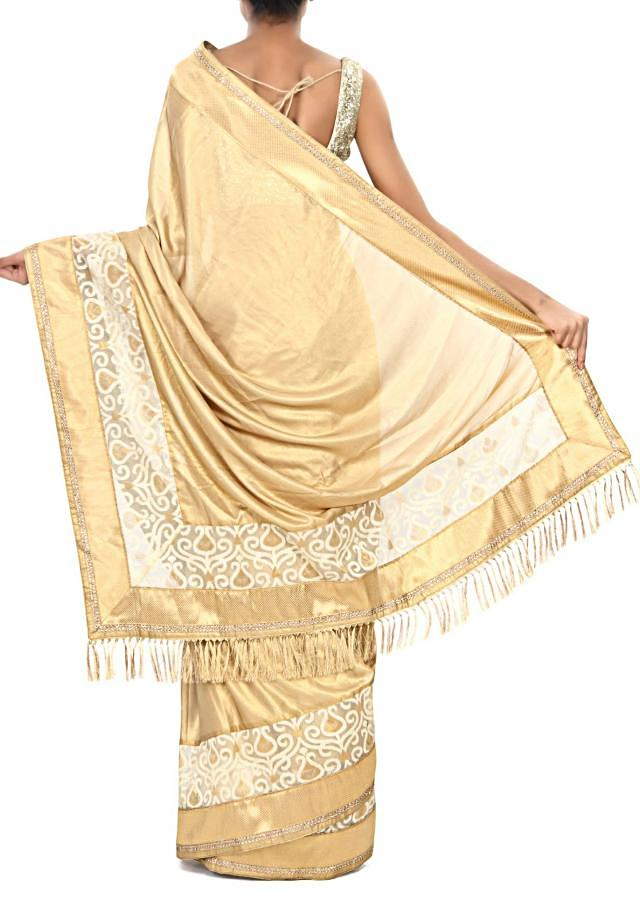 Gold shimmer saree embellished in weave embroidered border only on Kalki