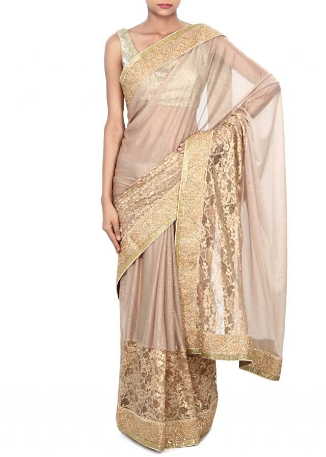 Gold shimmer saree enhanced in lace border only on Kalki