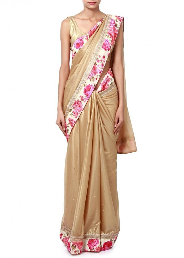 Gold shimmer saree featuring in floral printed border only on Kalki