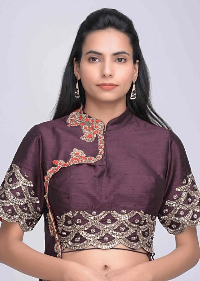 Gold silk lehenga with burgundy crop top with attatched half jacket only on Kalki