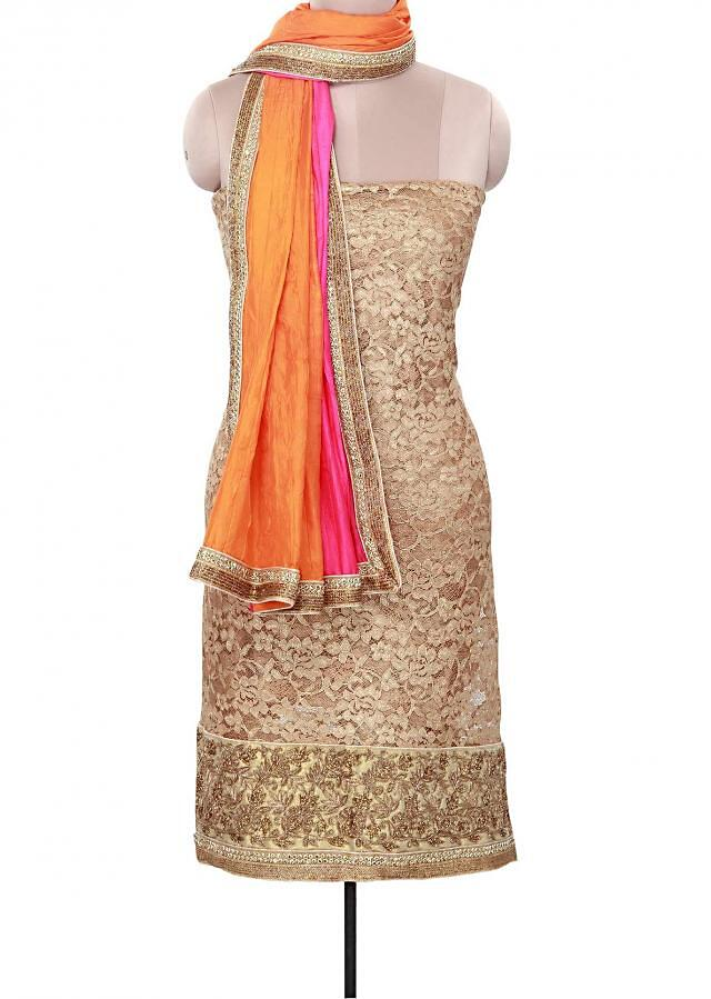 Gold unstitched suit adorn in kundan and zardosi embroidery only on Kalki