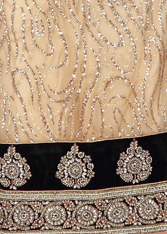 Gold unstitched suit matched with embroidered dupatta only on Kalki