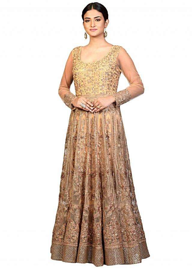Gold anarkali gown in embroidered net with zari work
