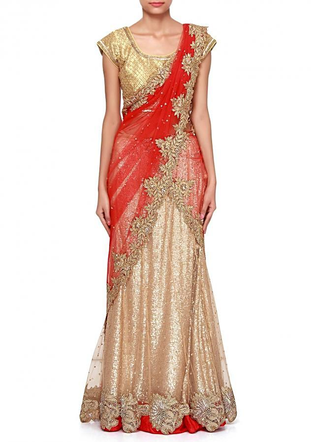 Gold and red lehenga saree adorn in zari and kundan embroidery only on Kalki