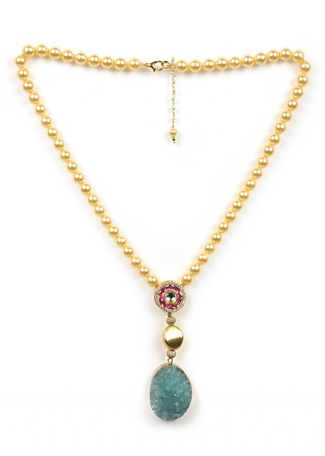 Gold beaded necklace with a blue crushed stone only on Kalki