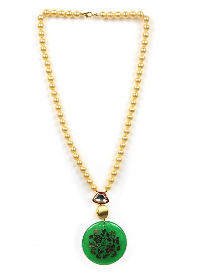 Gold beaded necklace with a green carved pendant only on Kalki