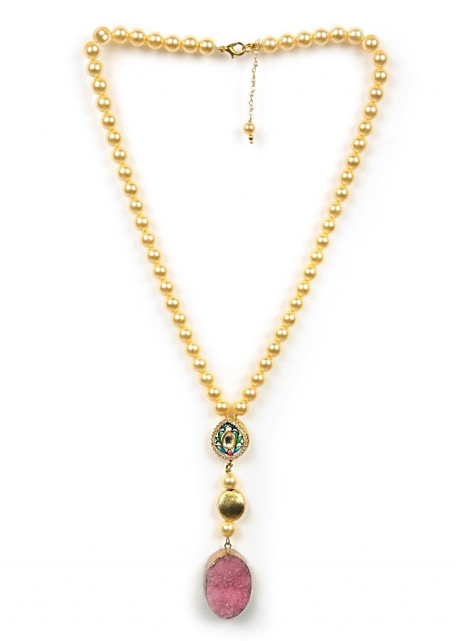 Gold beaded necklace with a pink crushed stone only on Kalki