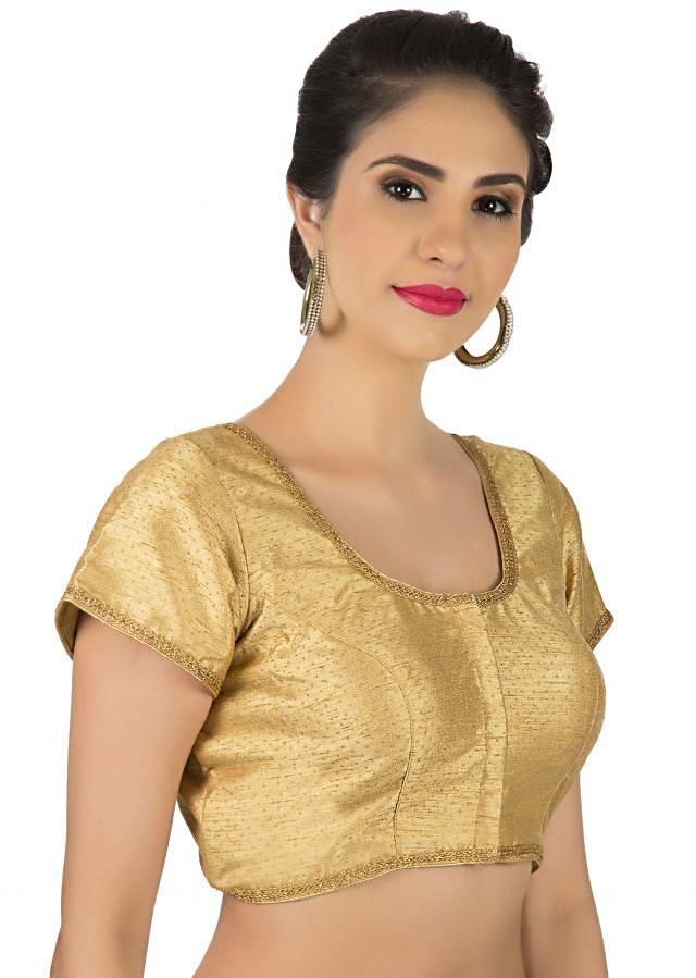 Gold blouse in raw silk with gold lace piping only on Kalki