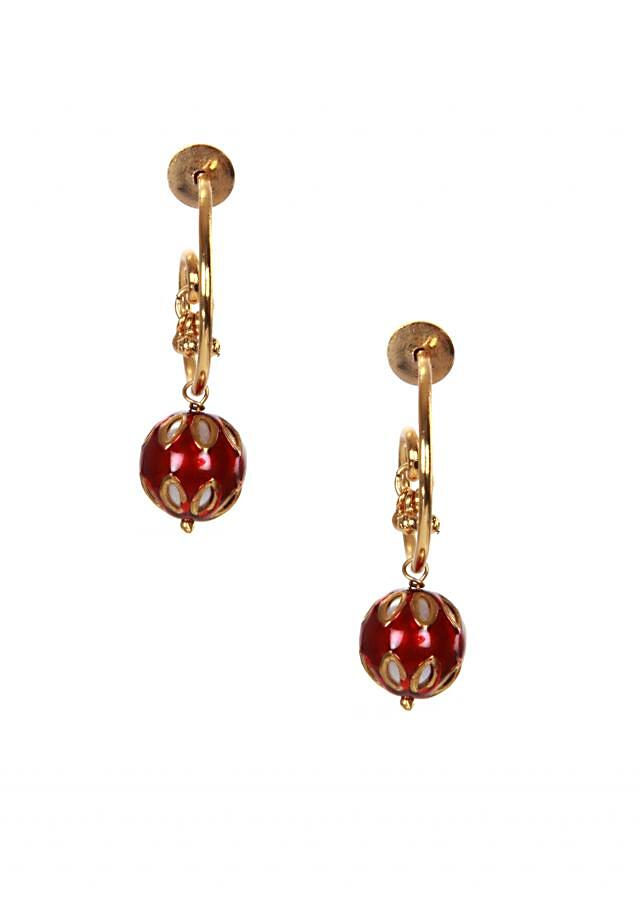 Gold earrings with drop red gemstones adorn with white jewels only on Kalki