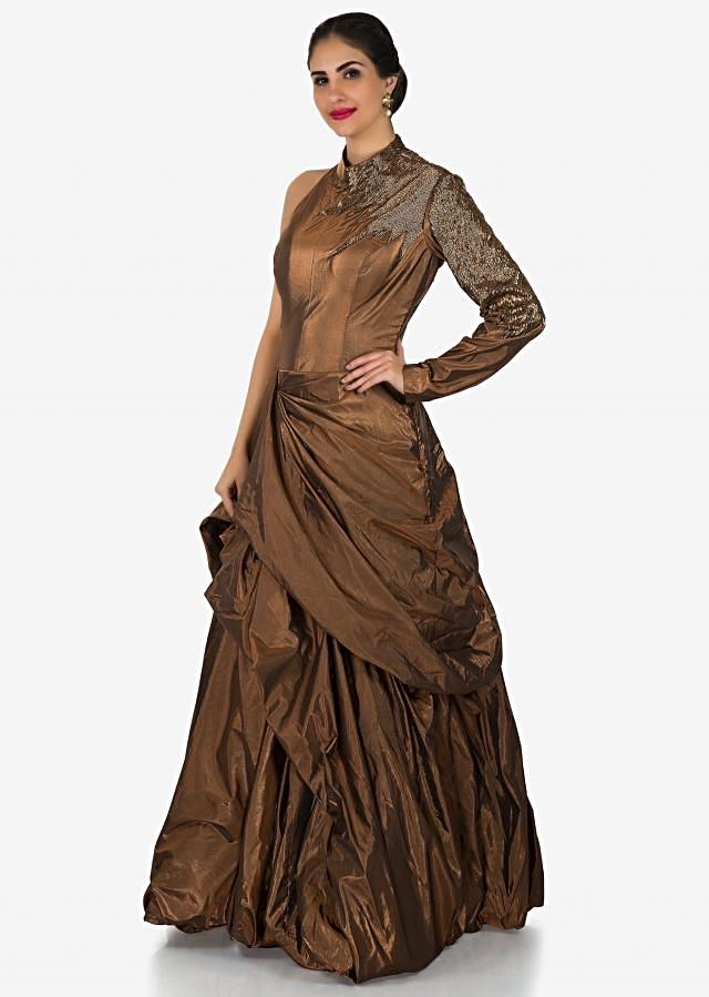 Gold gown in foil adorn in cut dana embroidery and fancy drape only on Kalki