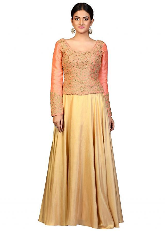 Gold lehenga in lurex with peach embroidered blouse
