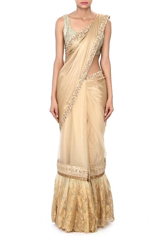 Gold saree enhanced in chantilly lace only on Kalki