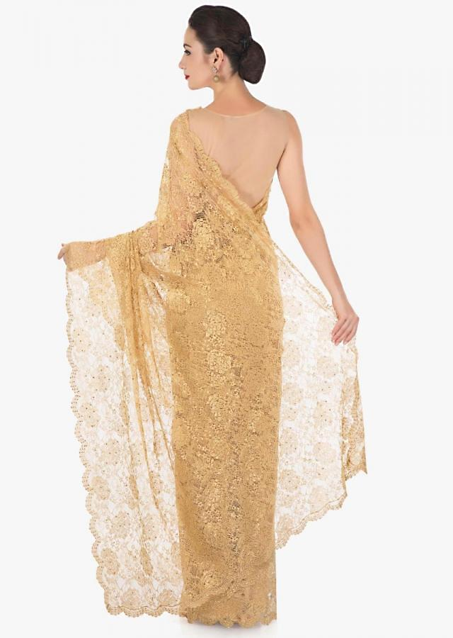 Gold saree in Chantilly lace further enhanced in kundan embroidery only on Kalki