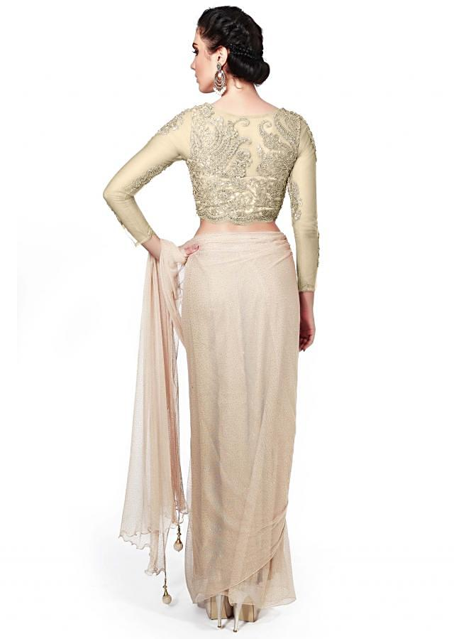 Crusted gold saree matched with  embellished blouse only on Kalki