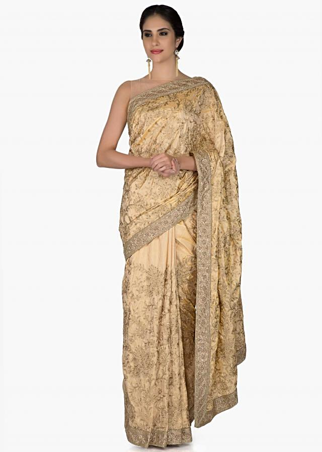Gold Silk Saree and Blouse Adorned with Aari and Kundan Work only on Kalki