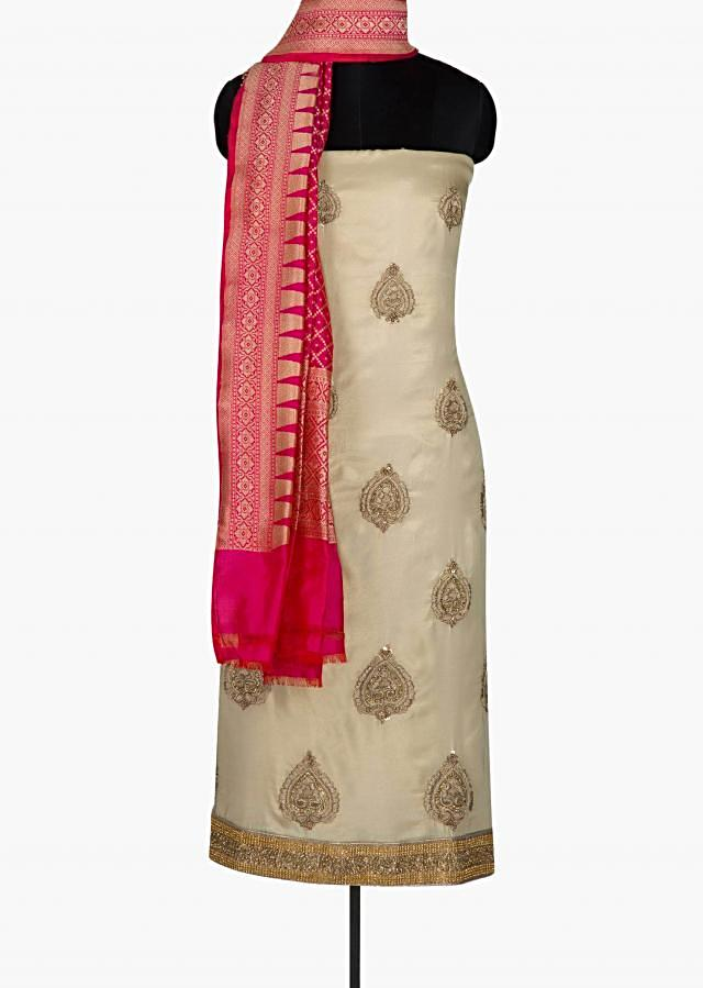 Gold unstitched suit featuring thread embroidered butti and zardosi work only on Kalki