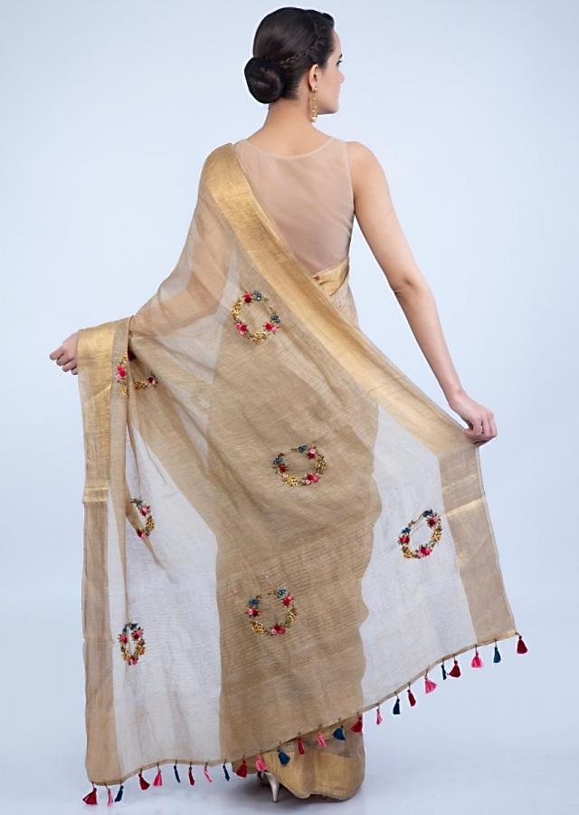Golden beige linen saree with multi color resham embroidered butti only on Kalki