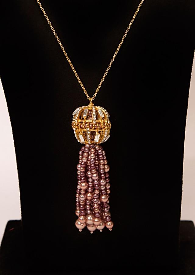 Golden chain necklace with an oval cut out broach with moti, stones and buggle beads
