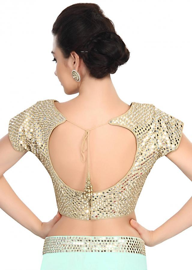 Golden blouse embellished in mirror and zari embroidery only on Kalki