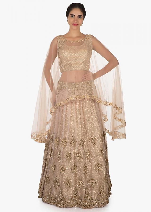 Golden lehenga with a cape enhanced in heavy sequin embroidery work only on Kalki