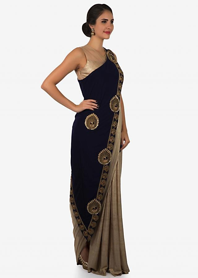 Golden shimmer lycra dress with fancy navy blue overlayer adorn in moti and frenchknot work only on Kalki