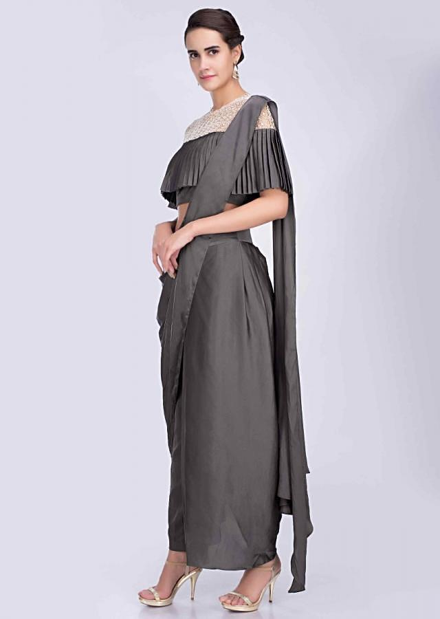Graphite grey dhoti saree with fancy cape style crochet blouse only on Kalki