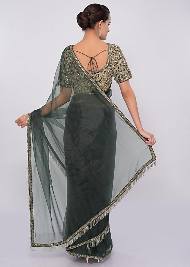 Graphite grey organza saree with tasseled pallo and border only on Kalki