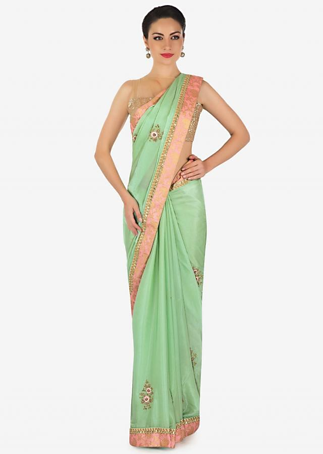 Grass green saree in satin with embroidered butti and border only on Kalki