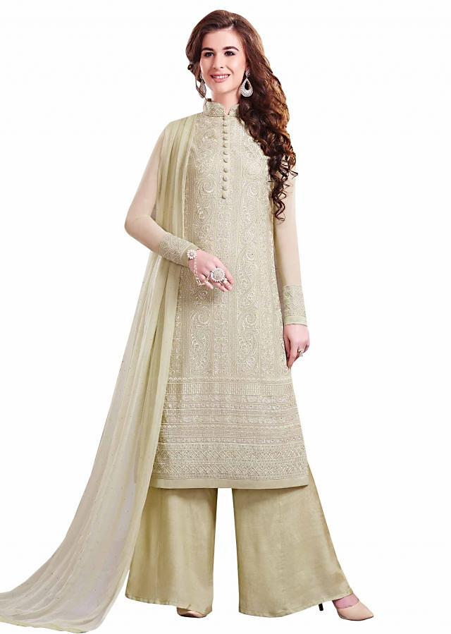 Grass green unstitched suit adorn in resham and kundan embroidery