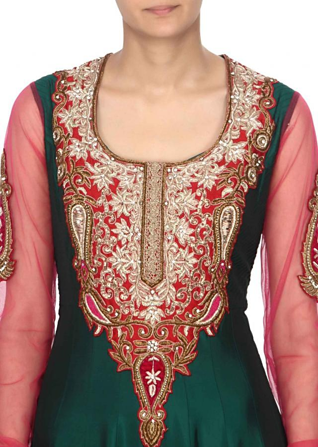 Green anarali suit embellished in zarodsi and zari embroidery only on Kalki