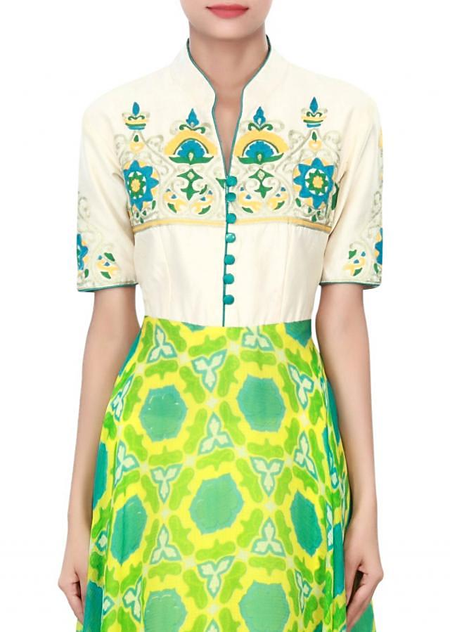 Green and cream kurti enhanced in thread and aari embroidery only on Kalki