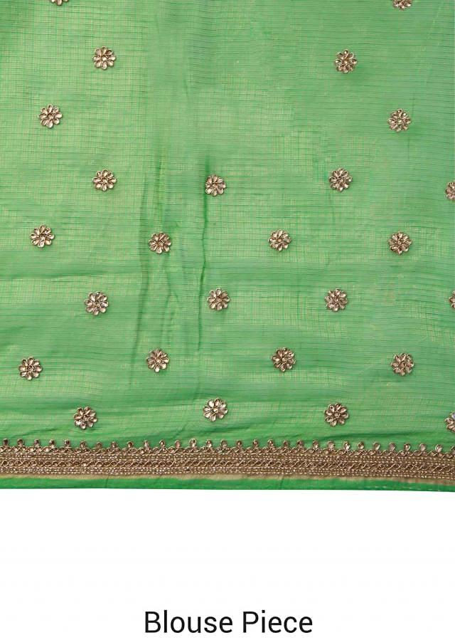 Green and gold saree adorn in kundan and zardosi butti only on Kalki