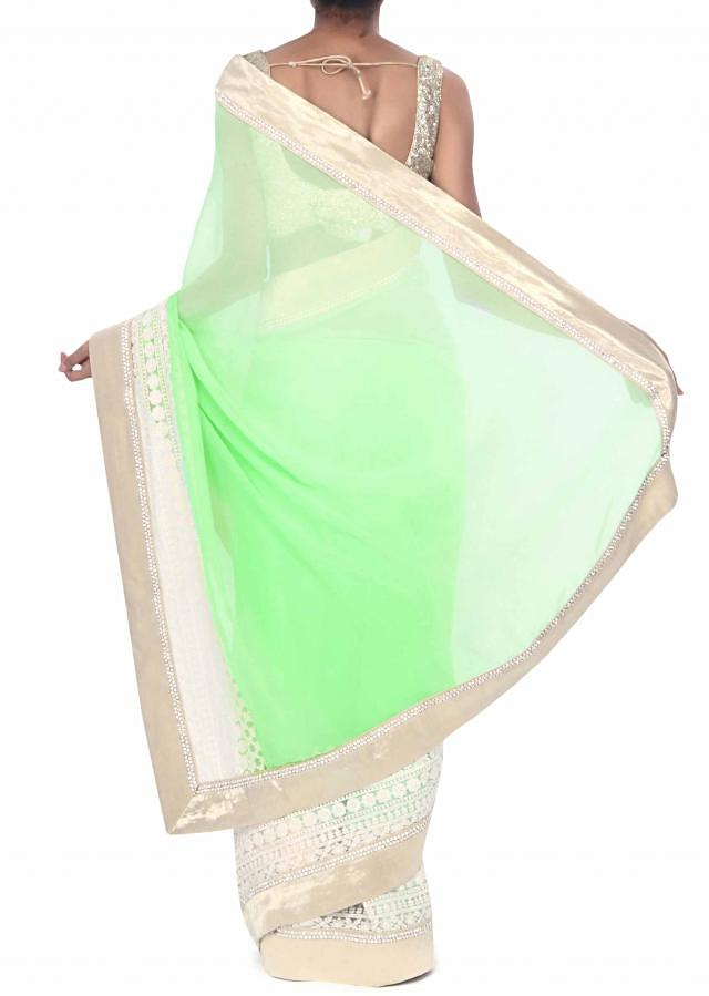 Green and white saree enahnced in gold border only on Kalki