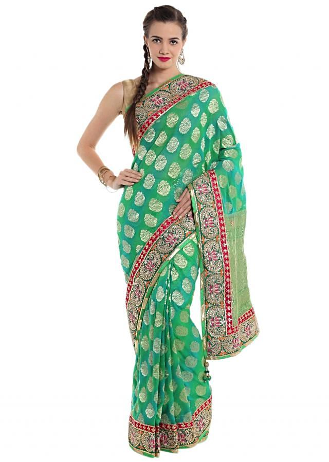 Green banarasi georgette saree endowed with gotta patch work only on Kalki