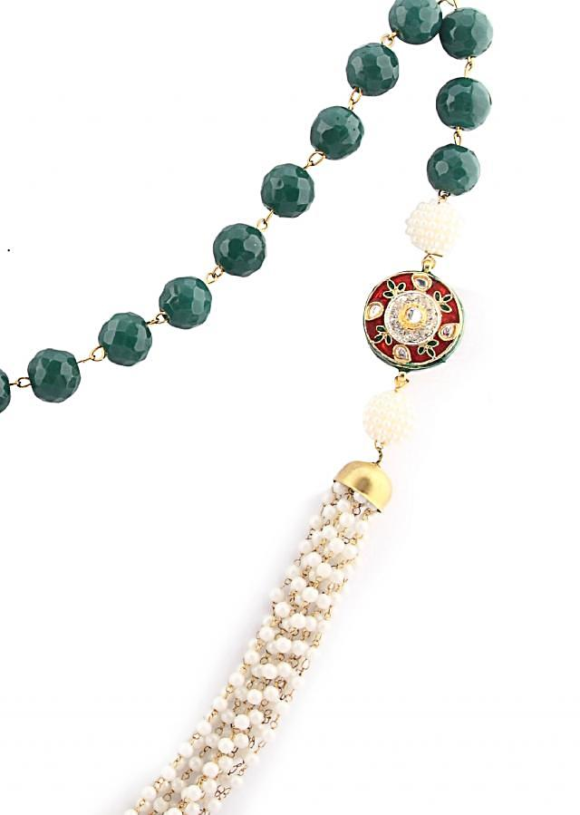 Green beads strung with pearls and chain with a broach only on Kalki