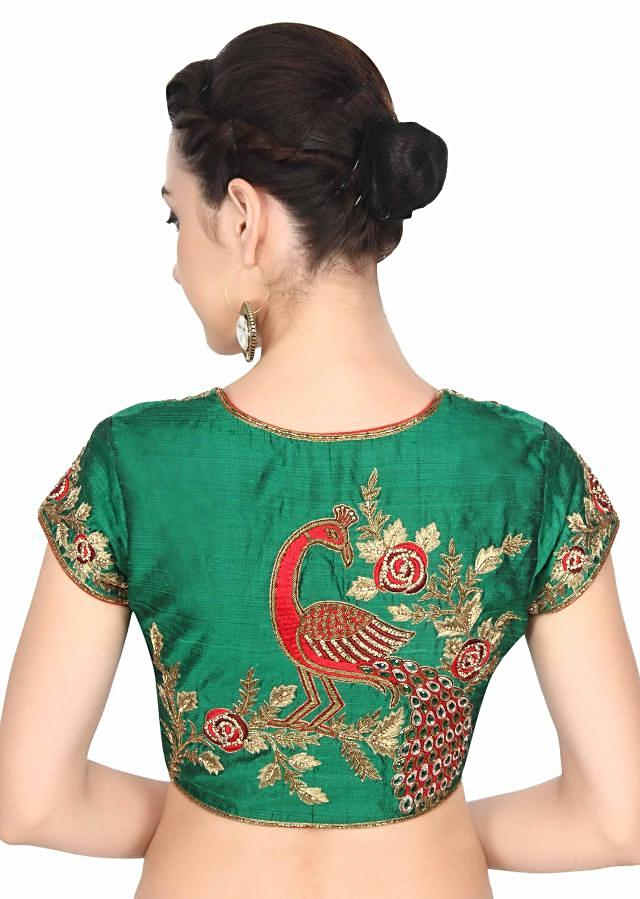 Green blouse adorn in peacock motif embroidery only on Kalki