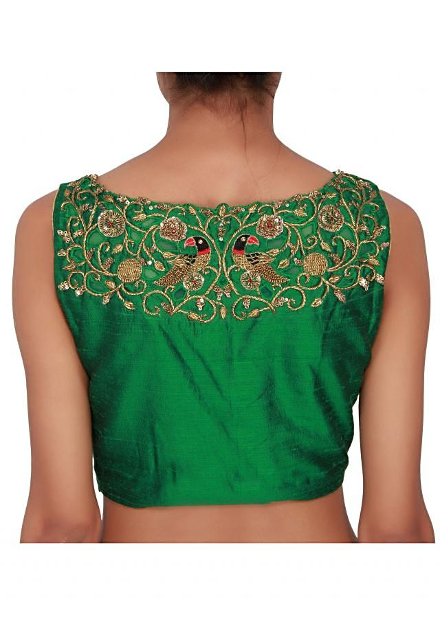 Green blouse featured in raw silk, embellished in gold zardozi work on the neckline both front and back only on Kalki