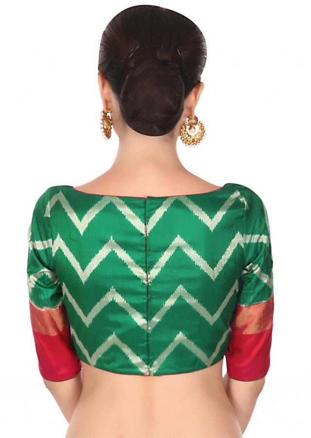 Green blouse featuring in ikkat print only on Kalki