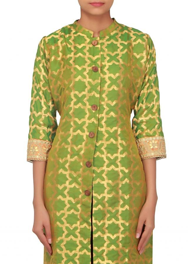 Green brocade kurti with fancy wood buttons only on Kalki