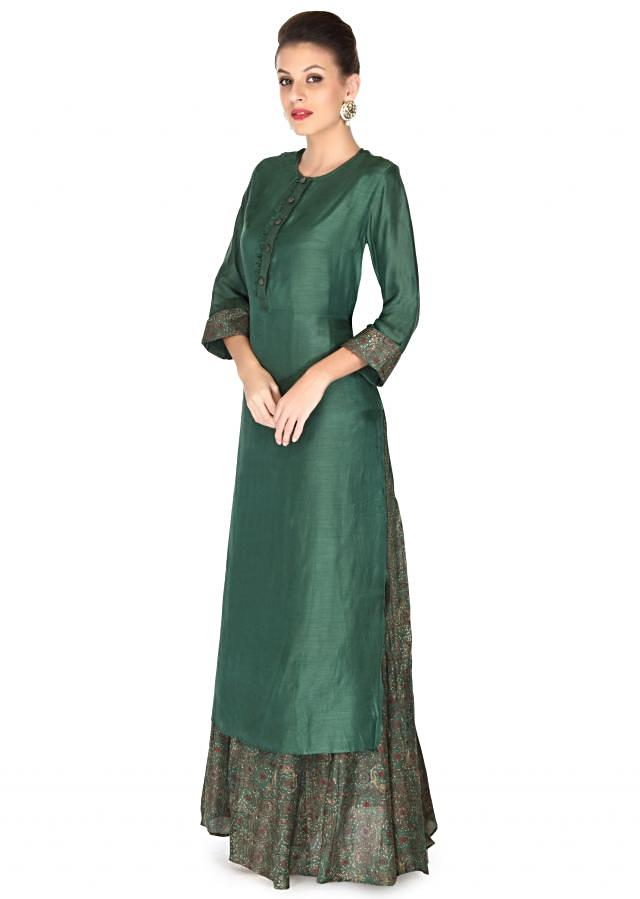 Green dress matched with long printed inner only on Kalki
