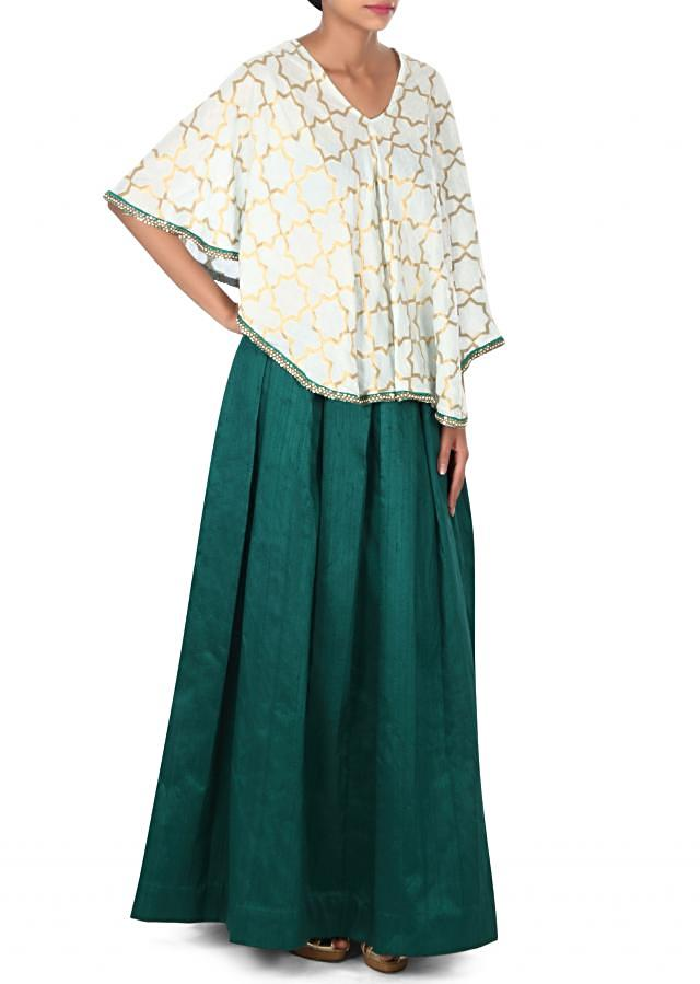 Green lehenga matched with white cape only on Kalki