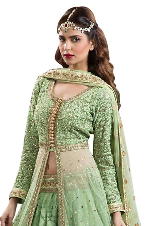 Green lehenga with long embroidered jacket blouse