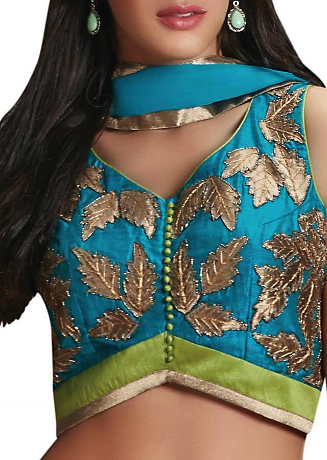 Green lehenga with teal blouse embellished in patch work