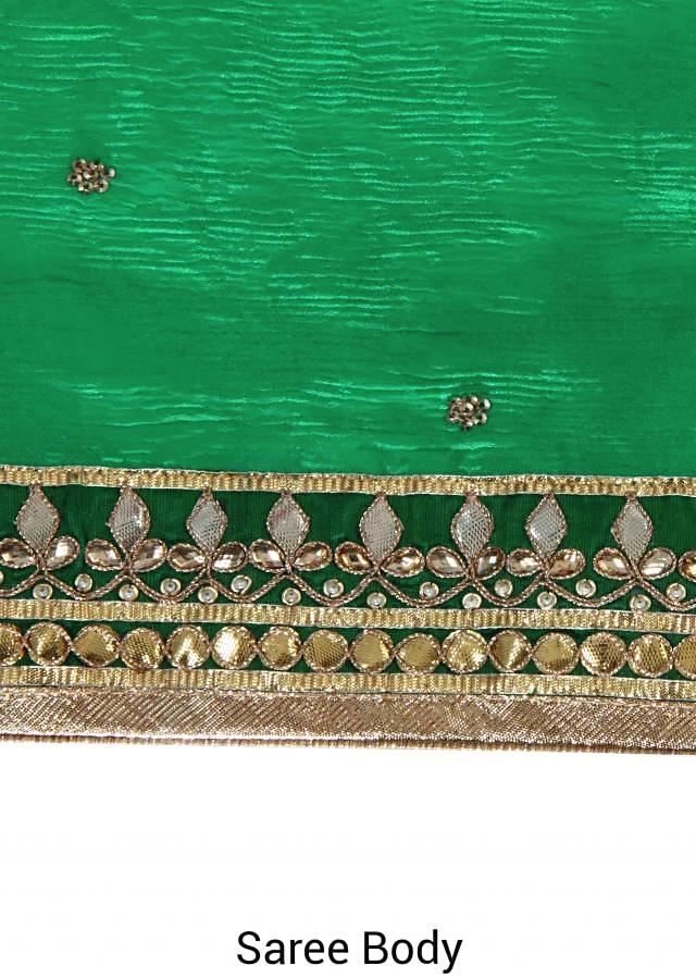 Electric green saree adorn in gotta patch embroidery only on Kalki