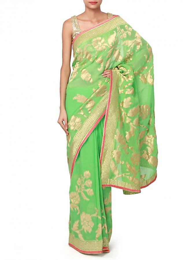 Green saree adorn in weave embroidery only on Kalki