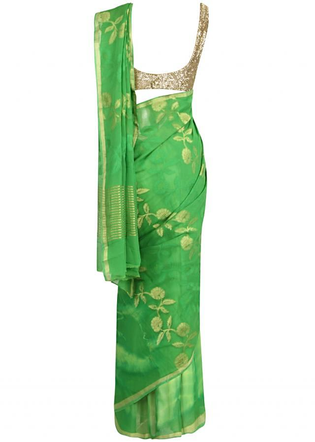 Summer ‌green saree adorn in weaved butti only on Kalki