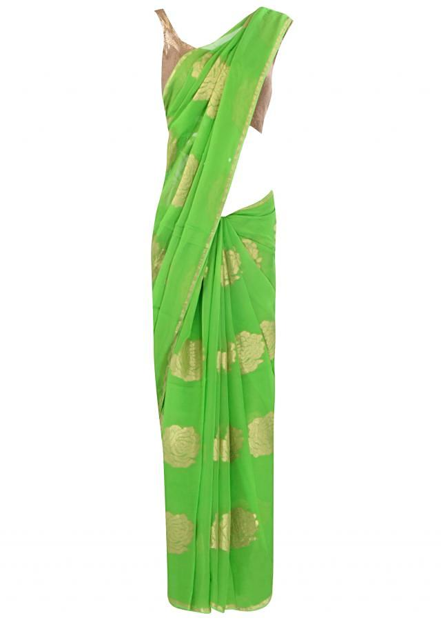Green saree adorn in weaved embroidery only on Kalki