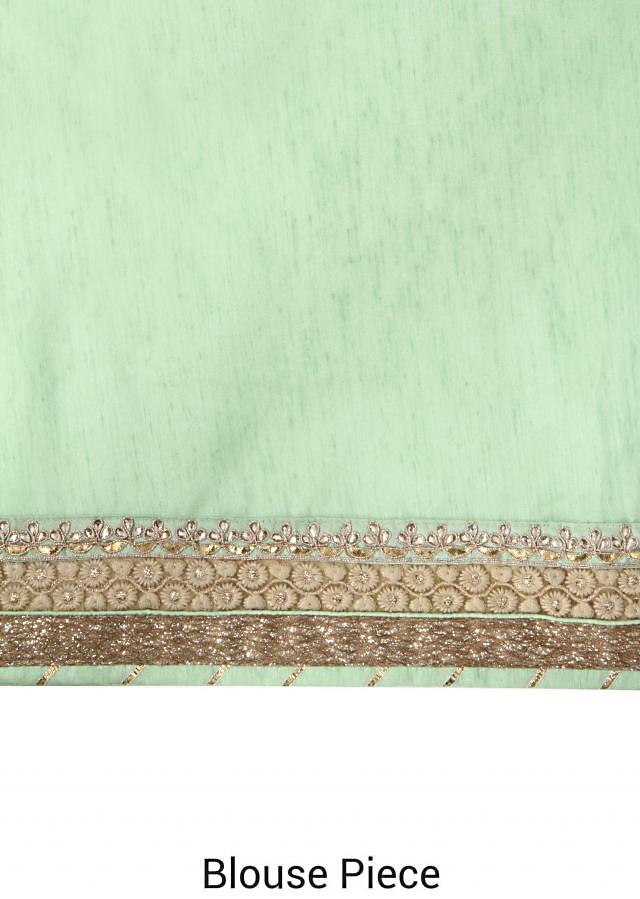 Luicite green saree adorn in zari and kundan embroidered butti only on Kalki